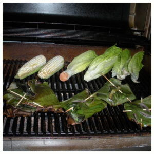 grilled fish in banana leaves, plus grilled corn and romaine