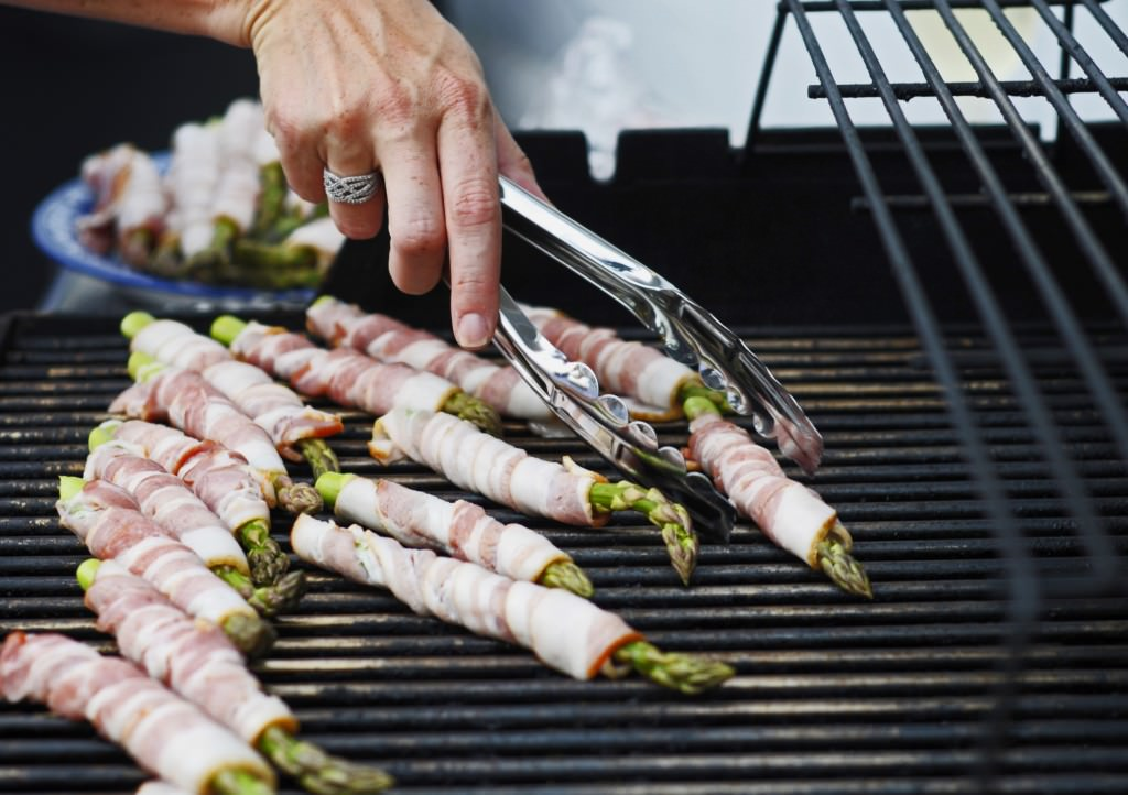Silvia Prado flips the bacon wrapped asparagus