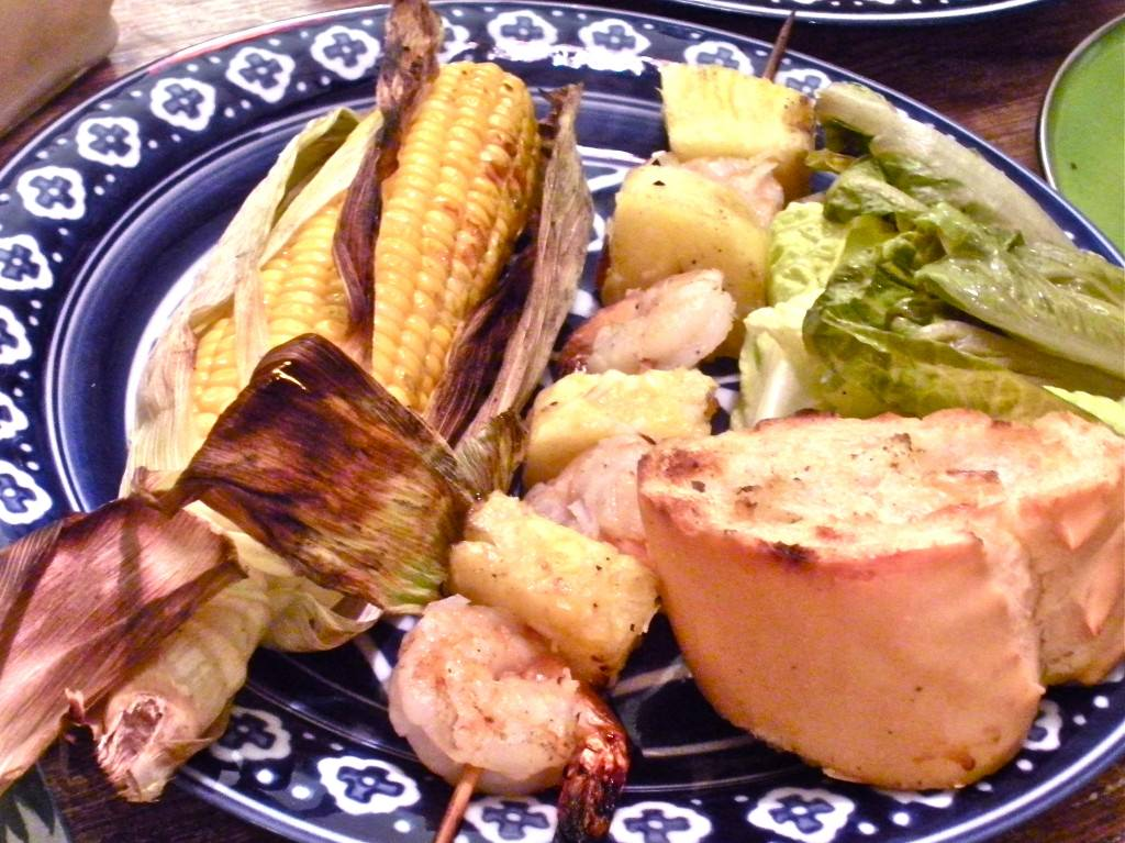 Grilled Coconut Shrimp Skewers with Grilled Corn with Lime Compound butter and Texas Toast.