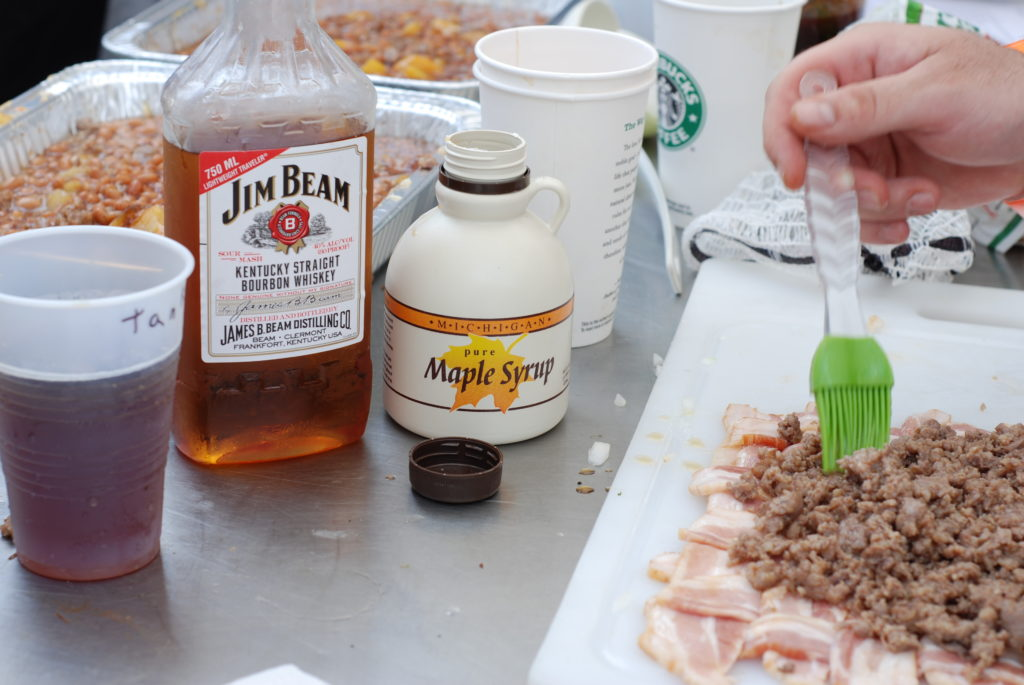 "The makings of a ""bacon explosion"" include a good basting of a Jim Beam/Maple Syrup mixture."
