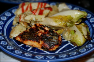 Grilled chicken in white BBQ sauce served with grilled endive and rosemary potatoes.