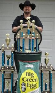 Jimmy displays his MANY competition trophies and his trusty Big Green Egg