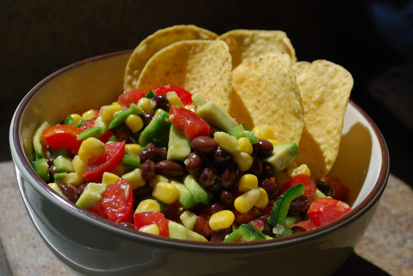 Cowboy Caviar sometimes called Mexican Caviar is like a cross between a bean salad and a fresh salsa It combines two types of beans black beans and black eyed peas with a colorful medley of fresh vegetables and a tangy limebalsamic vinaigrette
