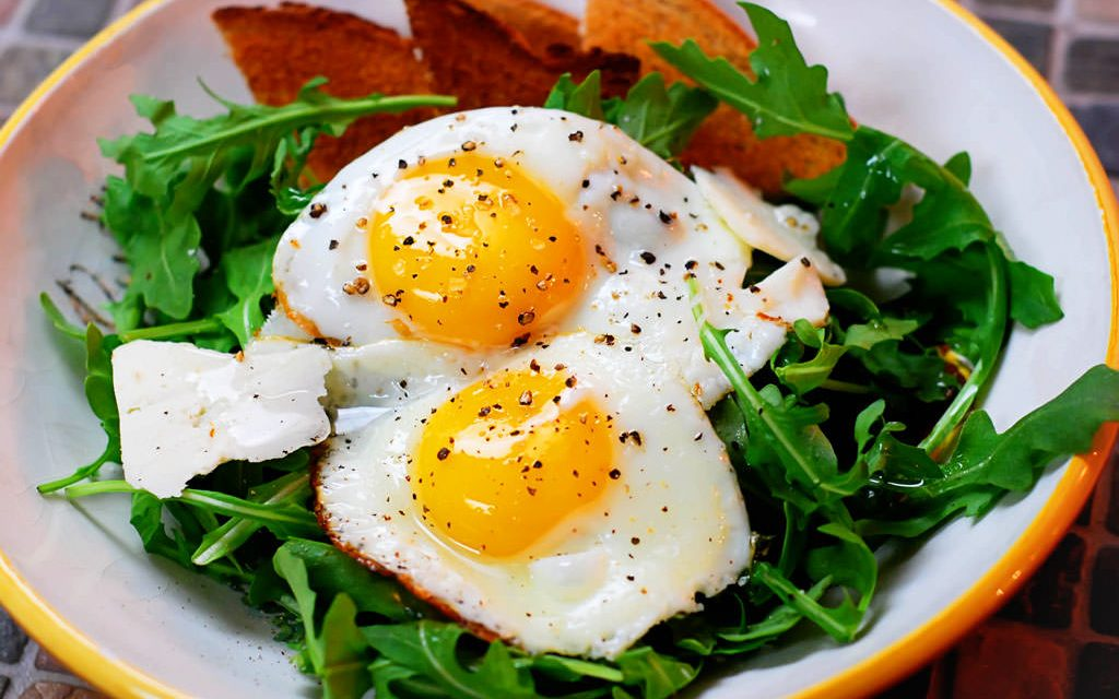 Breakfast Salad: Eggs Over Easy Over Arugula with Shaved Parmesan