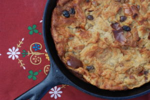 This bread pudding can be made on the grill in a skillet or easily baked in the oven.