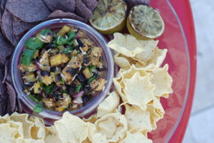 Grilled pineapple, jalapenos, cilantro, black beans, limes and coconut = light and refreshing salsa with a kick!
