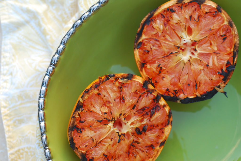 Grilled the grapefruit caramelizes the sugar and actually brings out its sweetness while also adding subtle smoky flavor.