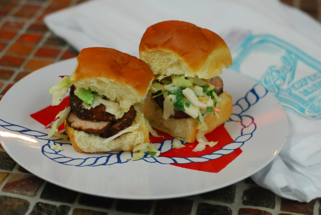 "Feed a crowd with pork tenderloin by turning them into sliders. I paired my ""Island spice"" pork tenderloin with slaw and put them on King's Hawaiian rolls for a tasty yet economical way to serve a crowd."