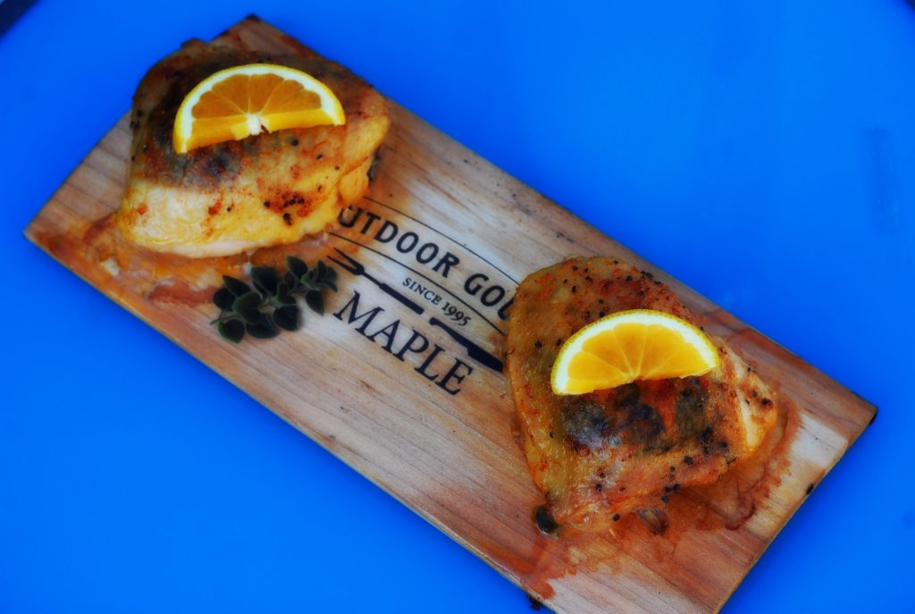 Add lemon wedges and a sprig of oregano for a pop of color. Use the planks as a plate for rustic presentation.