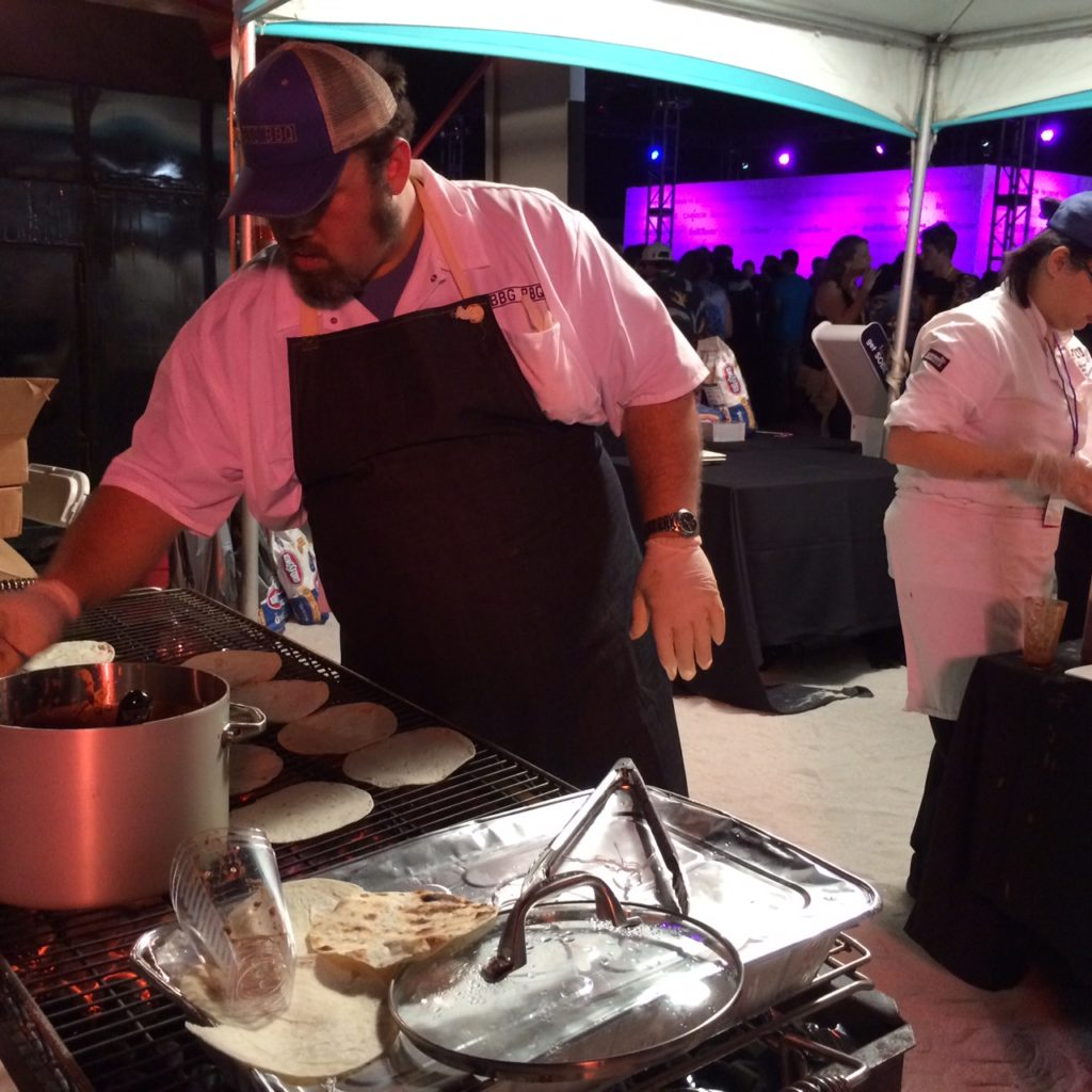 Ken Hess, Pitmaster for Big Bob Gibsons BBQ and right hand man to Chris Lilly, dishes up Pulled Pork Tacos.