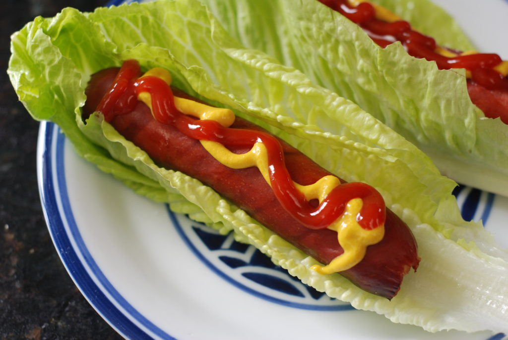 "Go bunless- eat your hot dog ""green style"", substituting lettuce for your bun."