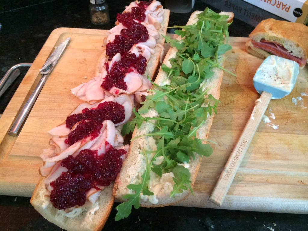 Turkey sandwich with brie and cranberry arugula rosemary thyme mayo grill girl