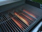 Clean grill grates on the Weber Genesis grill.