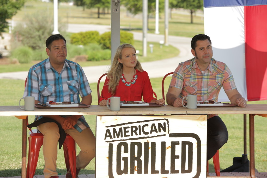 American GrilledAustin: The judges listen as a contestant explains the grilled dish they are about to try. (Photo Courtesy of The Travel Channel)