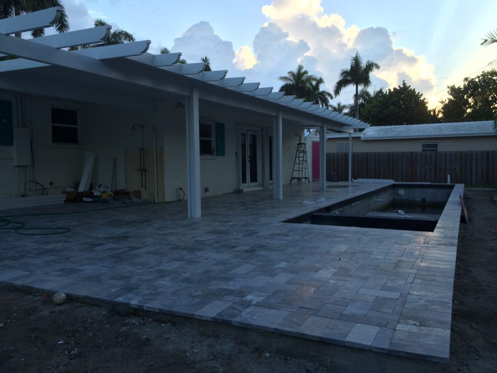 The pool is almost finished and the new porch has been added on. Almost there!