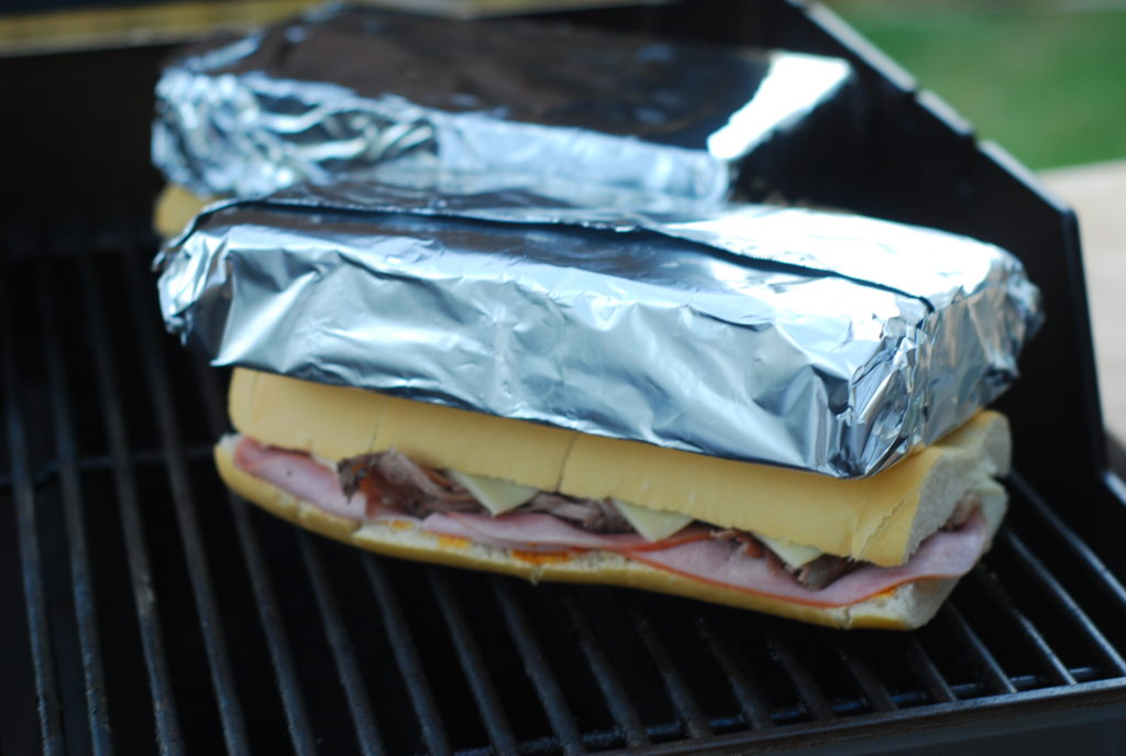 The brick acts as a panini press on the grill. You can also use a cast iron skillet if you don't have a brick.