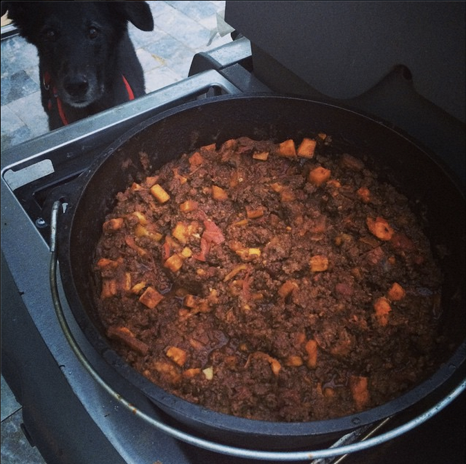 As I currently have no kitchen due to a massive house renovation, I made this chili on the side burner of my weber on my dutch oven. You could also easily make this in the crock pot if you halved the recipe. Haley is looking on, happy to sample what may be dropped!!