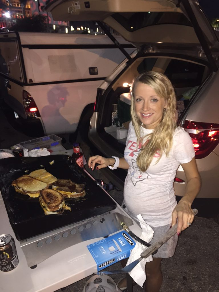 Here I am making Barbecue Brisket Grilled cheeses at the tailgate.
