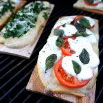 cedar planked pizzas on the grill