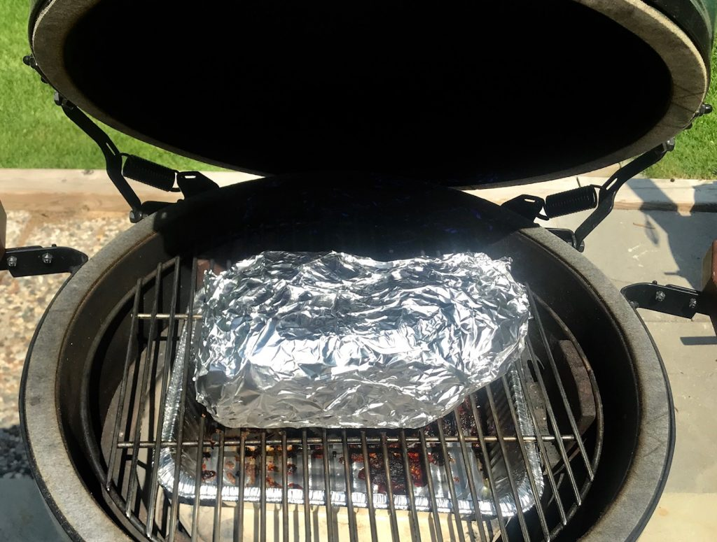 grill girl, big green egg, pork butt wrapped in foil