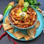 grill girl, smoked chicken chili in a bowl with tortillas