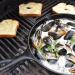 Cast Iron Grilled Mussels in a White Wine, Bacon Herb Butter Sauce